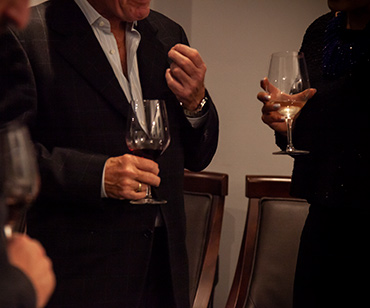 an image of men holding glasses of wine